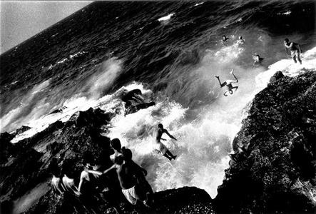 Boys jumping off the Malecón, Havana