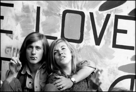 Two young protestors rest outside the convention hall during the turbulent 1968 Democratic National Convention.