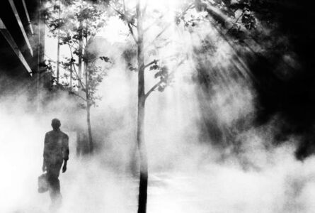 Trent Parke AUSTRALIA. Sydney. An office worker on his way to work walks through Martin Place.