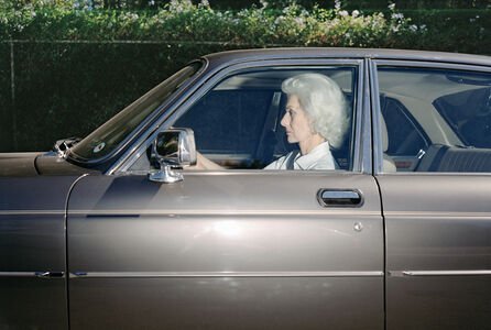 Woman caught in traffic while heading southwest on U.S. Route 101 near the Topanga Canyon Boulevard exit, Woodland Hills, California, at 5:38 in the summer of 1989
