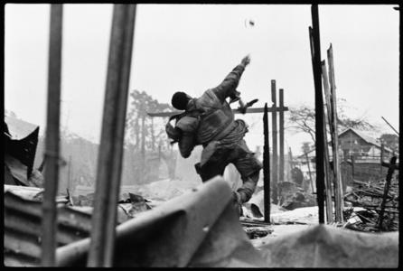 US Marine throwing hand grenade, Hue