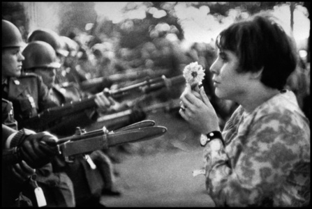 An American woman confronts the American National Guard outside the Pentagon during the 1967 anti-Vietnam march. Washington D.C.,
