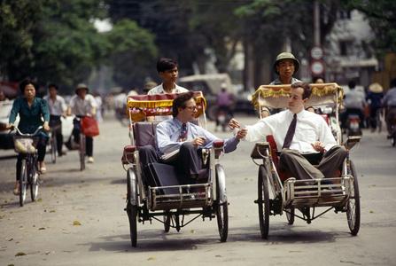 Businessmen on Hanoi Cyclos