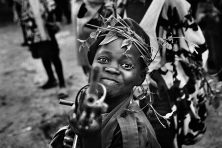 A child soldier with the Mayi-Mayi militia waits in Kanyabyonga as CNDP rebels advance. He was recruited while young men in the area were being abducted by the rebel forces. He didn't want to be forced to fight, so he volunteered with the Mayi-Mayi