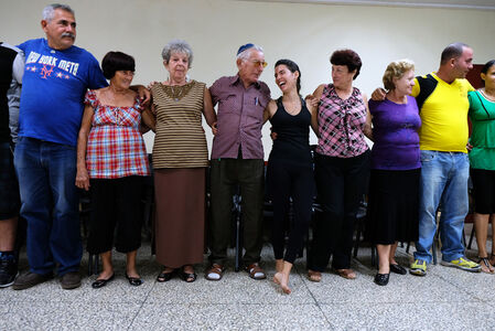 Members of the Jewish community dance the Hora at the Beth Shalom Synagogue