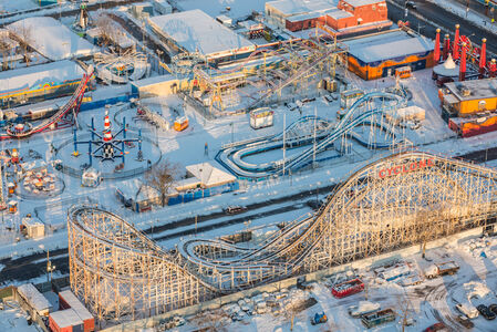 Coney Island's Luna Park hibernates under a soft blanket of snow.