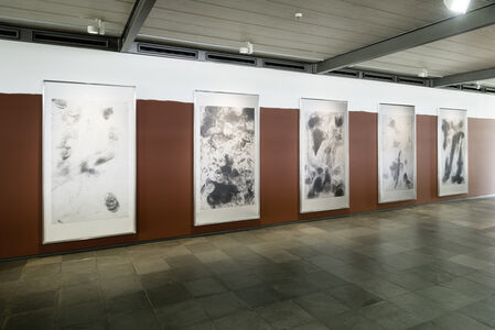 Andrea Büttner. Beggars and iPhones
