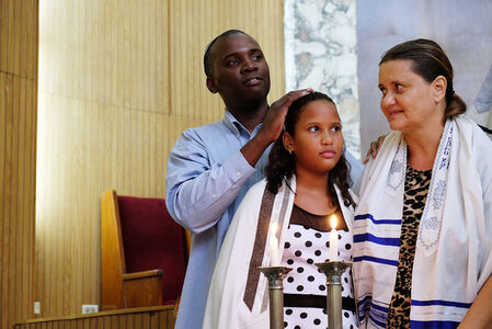 Parents participate in their daughter's Bat Mitzva inside the Beth Shalom Synagogue