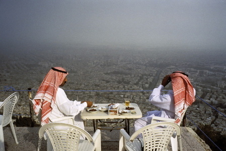 Saudi tourists at a cafe on Mt. Kassion, Damascus, Syria