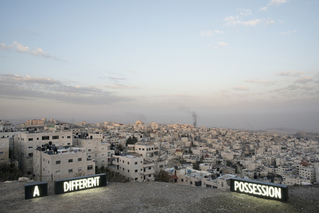 A DIFFERENT POSSESSION, Three on location light boxes, looking onto the Palestinian Village Issawiyah, annexed by Israeli in 1967, from Mount Scopus, Jerusalem