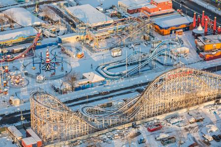 Coney Island's Luna Park hibernates under a soft blanket of snow.