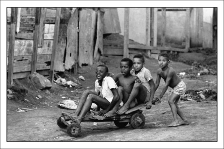 Boys on wooden stand in Morro da Mangueira