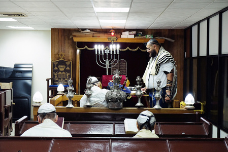 The Rabbi of the Sefarati Synagogue presides over a service
