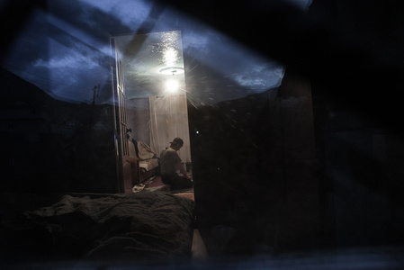 Ramazan Praying in His Home