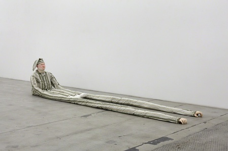 Untitled (Sitting man with green stripes and long arms)