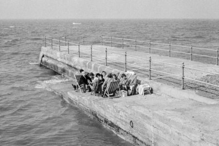 Herne Bay holidaymakers determined to enjoy their holiday. England.