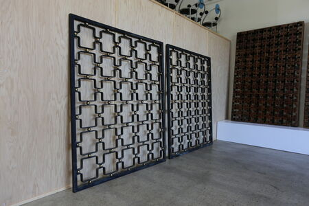 Iron and brass pair of architectural screens.