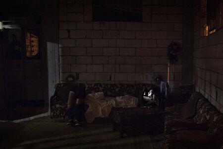 Mohamed sleeps through the day and surfs the internet for a girlfriend at night. Rashidiyeh, Lebanon