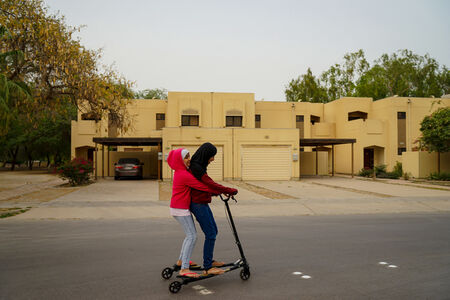 Saudi Woman can scooter, but can't drive. My daughters appear young, no one will harass them