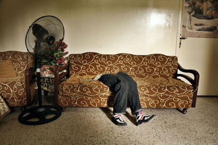 The prosthetic legs of Mohammed, lie on a sofa at the Rashidiyeh camp for Palestinian refugees. Rashidiyeh, Lebanon.