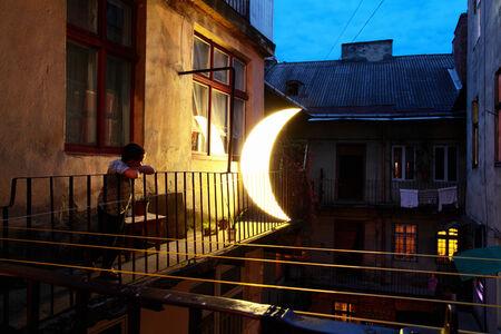 Boy and Moon on Balcony, Lviv, Ukraine