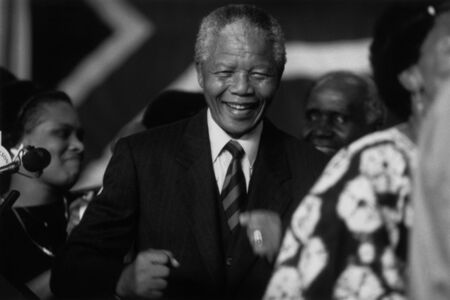 A jubilant Nelson Mandela after the announcement proclaiming ANC victory in South Africa.