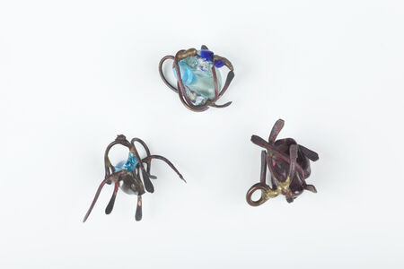 Three copper and glass pendants