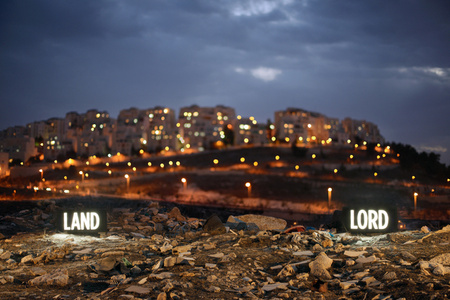 LAND LORD, Two on-location light boxes, looking onto the Israeli settlement Har Homa from the Palestinian Village Umm Tuba, annexed by Israel in 1967