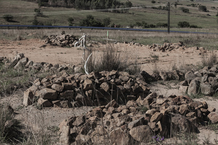 Driefontein graves and relocation place over yonder. Compensation for accepting relocation is a cow for an adult's corpse and a goat or sheep for a child's corpse.