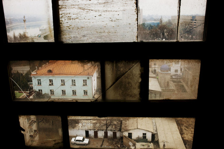 """Khujand viewed through a window in the Leninabad Hotel. The city was established by Alexander the Great 2,500 years ago on the banks of the Syr Darya (framed in the upper left corner). From """"Two Rivers"""""""