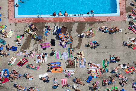 POOLSIDE TANNING, CAMBRIDGE, MASSACHUSETTS, USA, 2012