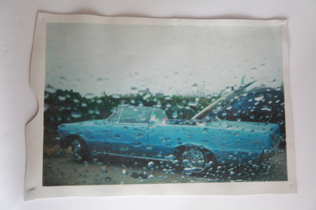 White Leather Series: Blue Cadillac at Ditch lot