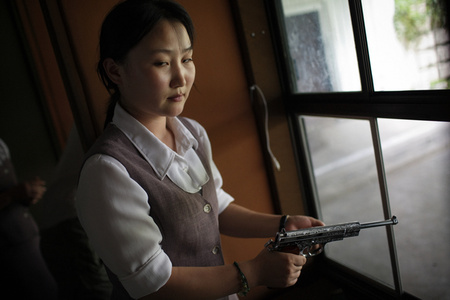 A North Korean woman loads a pistol for firing practice in Pyongyang, North Korea