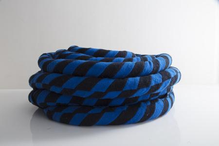Unique coil sculpture in blue and black cashmere, kapok fiber filling