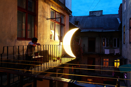 Boy and Moon on Balcony, Lviv, Ukraine