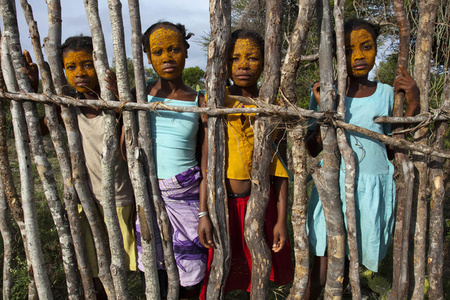 Adolescent Malagasy girls with beauty mud on their faces, Madagascar