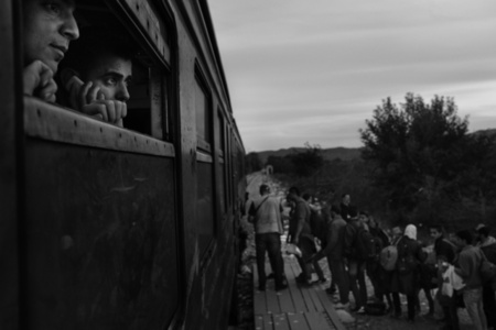 Refugees prepare to board a train at Gevgelija