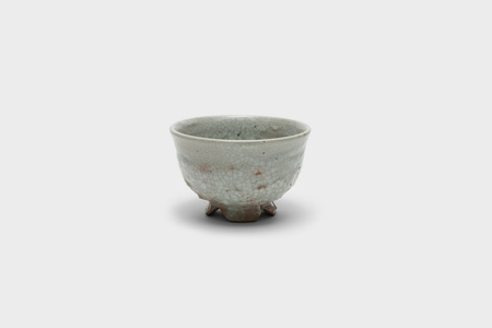 Old white porcelain tea bowl with cut foot