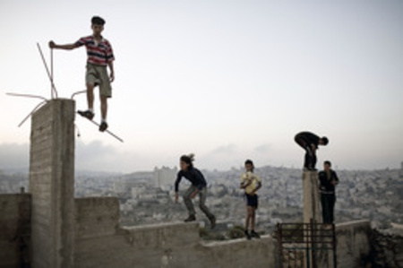 Boys playing on a hill overlooking Bethlehem (Palestine)