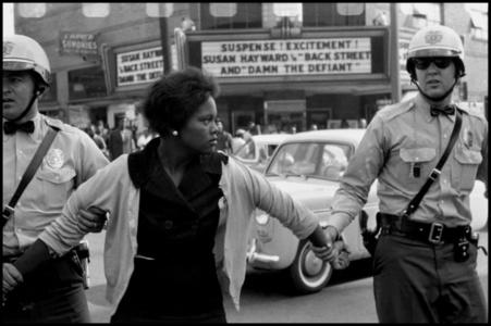 "Arrest of a demonstrator. ""Damn the Defiant!"". Birmingham, Alabama. USA."