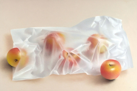 RED APPLES WITH PLASTIC SACK