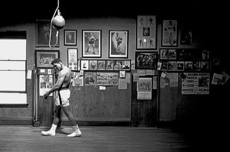 Muhammad Ali Walking in Gym