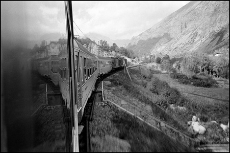 Train in mountainous landscape in soutwestern France, between La Tour de Carol and Foix.