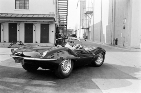 Steve McQueen in black Jaguar at Studio, CA