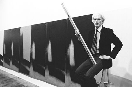 Andy Warhol in front of Shadows at Heiner Friedrich Gallery, New York