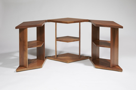 Low table with three diamond-shaped elements and superimposed shelves