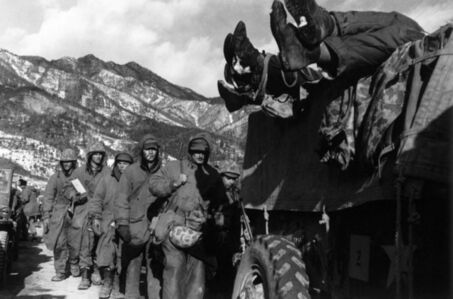 Marines File Past a Truck Load with Dead Troops during Retreat from Chosin Reservoir in December