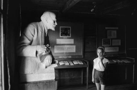 A little girl looks at the Lenin bust. Poronin, Poland