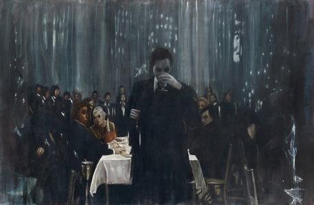 Man in front of Table