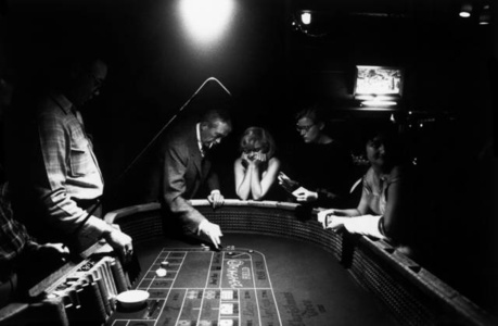 Marilyn Monroe gambling with John Huston (Reno, Nevada)
